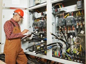 adult electrician builder engineer worker with electric scheme p